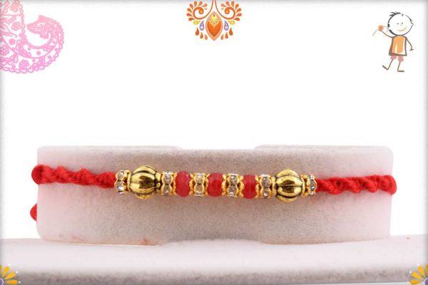 Red Bead Diamond Rakhi with Golden Beads