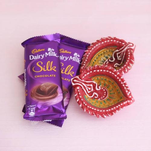 Set Of 4 Designer Clay Diya And Chocolates
