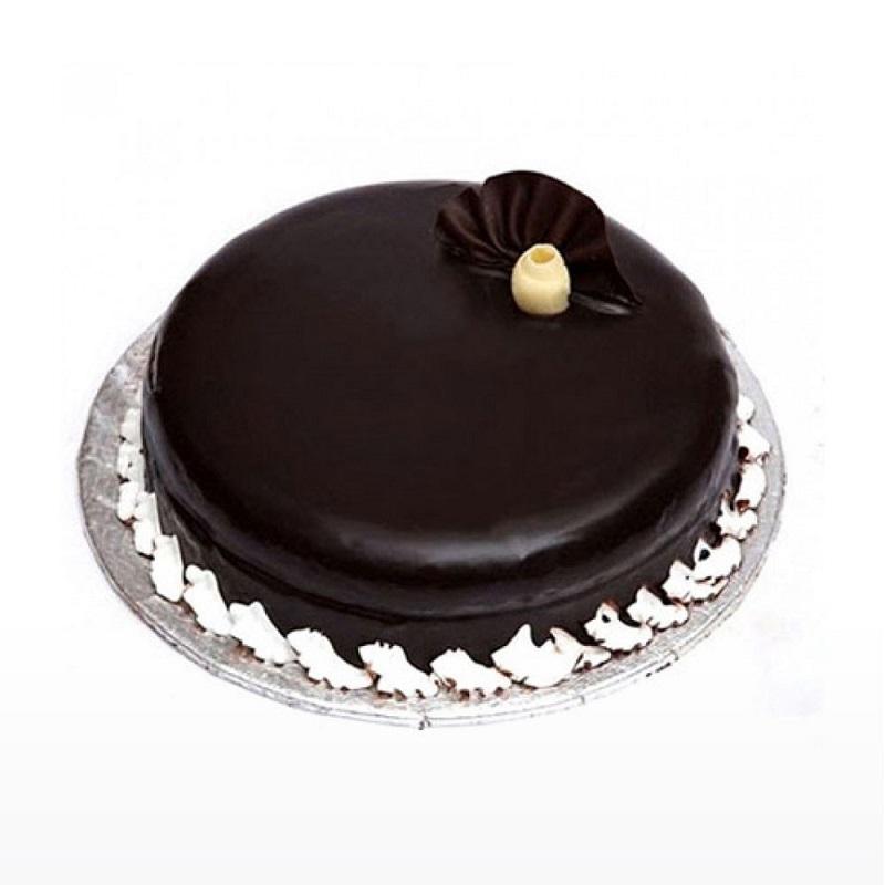 Round dark chocolate cake