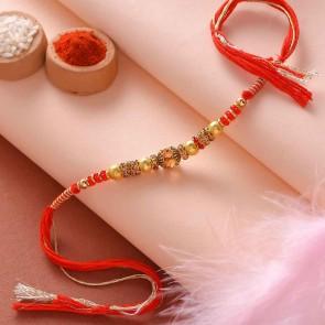 Golden Beads And Stones Rakhi