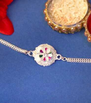 Flower Patterned Silver Rakhi