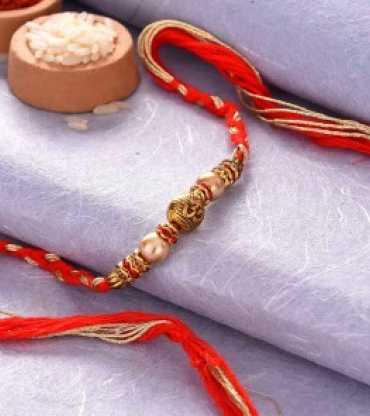 Om Antique Bead And Pearls Rakhi