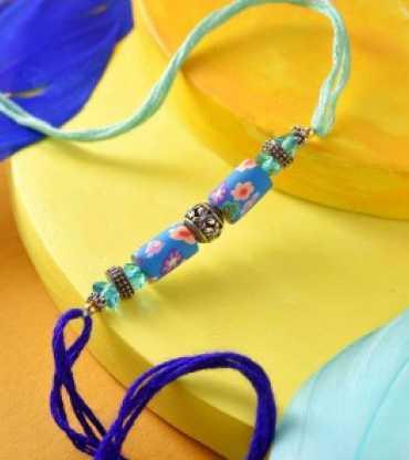 Floral Pattern Oxidised And Blue Beads Rakhi